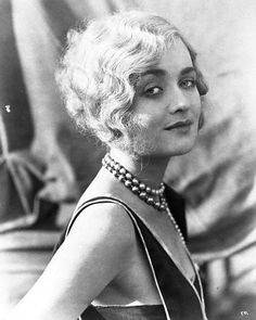 I love this 1920's finger waved bobbed hairstyle.  This might be the one-or as close to it as the hairdresser can get that is.