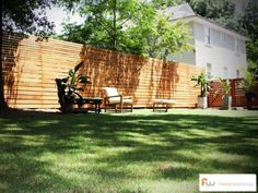 This is a modern horizontal board wood privacy fence design that is one of the coolest fences on the internet.