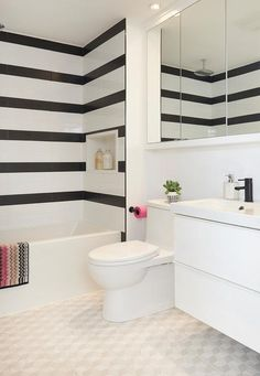 Ali Budd Interiors - Contemporary black and white bathroom boasts white and black striped shower tiles fixed framing a white niche positioned over a drop-in bathtub. Bathroom Basin Taps, Bathtub Tile, White Bathroom, Small Bathroom, Shower Tiles, Black And White Flooring, Black And White Tiles, Dream Bathrooms, Beautiful Bathrooms