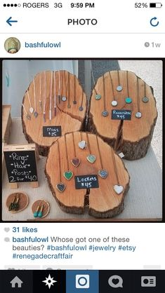 Wooden logs cut at an angle to display necklaces. Smaller ones for earrings. Love the signage too #JewelryDisplays