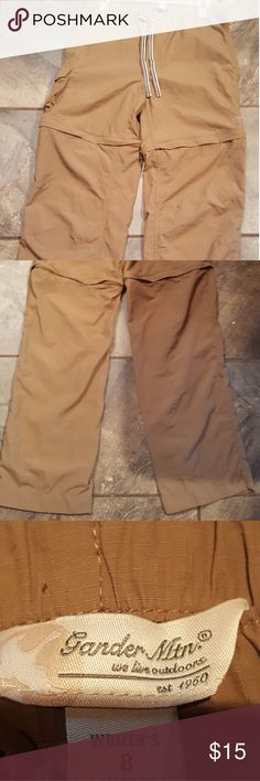Hiking pants Khaki light weight. Easy to dry when wet. Elastic draw string waist. From waist to crotch are 10 inches. Length 36 to 38 inches. Unzips at legs to make shorts and pants can even roll up with two snaps on each side. Gander Mountain Pants Track Pants & Joggers