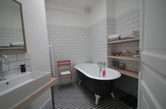 Grey and white bathroom, with Mutina Azulej floor tiling and retro tub by Murs & Merveilles | www.mursetmerveilles.fr
