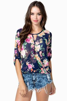 Get twisted up in some lovely floral! A sheer chiffon top featuring a floral print and a surplice front. Round neck. Long sleeves with button tabs. Keyhole back with a button loop closure. Partially bubbled hem.