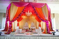 orange,hot pink,baby pink,Floral & Decor,ceremony,mandap,indian wedding decor,ceremony decor,indian wedding inspiration,inspiration for design at ceremony,fabric draped mandaps,colorful mandap,bright colorful color palette,Jason Groupp Photography