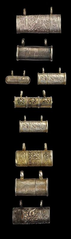 Malaysia / Singapore & Java | Collection of Nine Straits Chinese & Peranakan Children's Silver Amulet Boxes. Each of the 9 silver boxes is made in two halves that slide together | ca. 1900 || Sold
