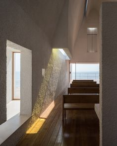 Vector Architects has built a little white chapel on a Chinese beach, but raised it up above the sands so that seawater can wash underneath. Named Seashore Chapel, the sculptural… Sacred Architecture, Church Architecture, Interior Architecture, Religious Architecture, Interior Design, New District, Glass Curtain Wall, Modern Church, Stucco Walls