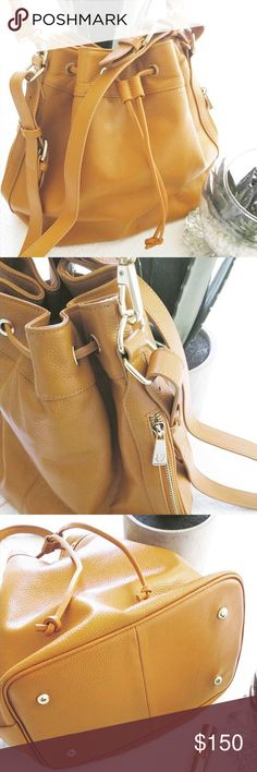 $368 TAN BUCKET BAG Perfect condition! Genuine Leather! Looks brand new with no flaws! Tagged under Free People for brand exposure! New style still on website 😍💕Got from another posher but didn't quite work out for me, absolutely gorgeous bag! Free People Bags