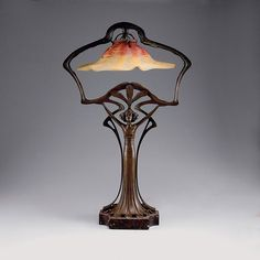 Art Nouveau - Daum Frères, Nancy. Table light, c1910. H. 55.2 cm. Cased glass, clear, milky white, red and orange powder fusions. Signed: DAUM NANCY. Metal mounting, patina. . 55,2 x 35,5 x 26,7 cm  - Quittenbaum Auctions
