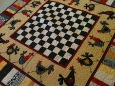 Chickens! The black and white checkerboard is a perfect center to this quilt.