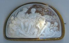 Special Antique Cameo Brooch This antique cameo brooch is a rare Victorian piece.  The engraved shell depicts a shore-side scene of seven maidens and one male admiring a bull.