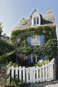 Blue shutters, ivy and a white picket fence!     French Brittany House
