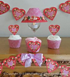 Free Printable Valentine Hearts Cupcake Toppers, Wrappers and Banners...There are instructions for making the toppers, wrappers and a banner in the zip file with the printables. Thank you Party Planning Center!