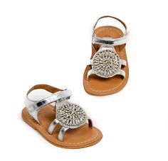 For spring, buyers are having a field day with the splendid, highly visual, and up-to-the minute selections at Pazitos. Here, the toddler sized (20 - 27) Medallion sandal in silver, with a stone medallion on top. www.pazitosinc.com