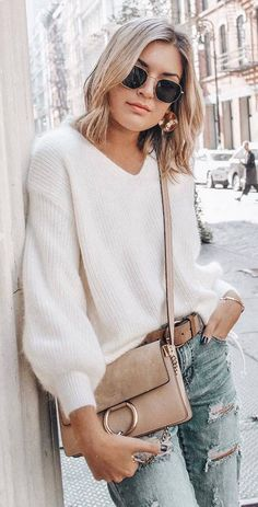 ootd white sweater   bag   ripped jeans