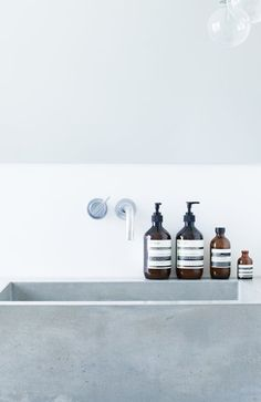 concrete sink and aesop