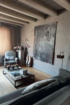 This is the house of the decorator Monique Meij in Holland. She renovated that small city house with grey shades. She lives on the top of th...