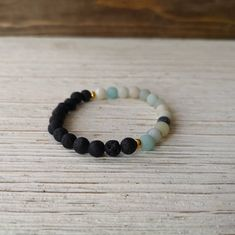 Matte Amazonite x Black Lava diffuser stone, gold by EssennzDesigns on Etsy Throat Chakra, Crystal Meanings, Stone Gold, Medical Conditions, Lava, The Help, Diffuser, Beaded Bracelets, Gemstones