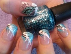 A very pretty and classy looking feather nail art French tip. Combine blue and white polish to create the French tip and add the feathers on top with a black polish. You can also add blue glitter polish for accent. Nails Polish, Peacock Nails, Feather Nail Art, Feather Print, Peacock Nail Designs, Feather Design, Teal Nails, Sparkle Nails, Color Nails