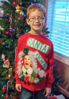 Ugly Christmas Shirt for my son's Ugly Christmas Sweater day at school. I made this Ugly Christmas Shirt in 14 minutes. ...I forgot to make it a head of time so I had to put it together before my son went to school that morning. I printed up Buddy the elf's pic and the words on my printer then I used laminating sheets to stick them onto the shirt. I then attached the garland and bows with double sided tape.