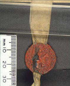 Seal of William Vavasour, given at Rothwell, Yorkshire West Riding.  Seal Design:  Design: caparisoned (dancetty) and crested horse galloping to right with rider holding a sword in the right hand and a shield of arms (dancetty) in the left, within a border of angles, Size: 20 mm, Shape: round, Colour: brown-red. Material: Wax  Date: 1283 November 20-1284 November 19