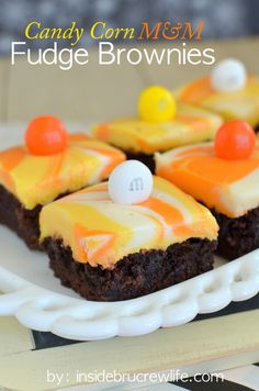 Brownies layered with a white chocolate swirled fudge and candy corn M and M's