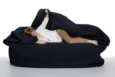 """Um...  YES PLEASE!!!  """"Moody Chair"""" A huge bean-bag like bed/chair with a built in pillow & blanket that you can wrap yourself in."""