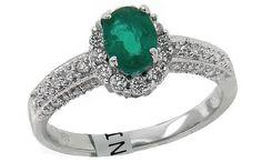 Brilliant cut diamonds surrounding emerald center stone. Check out Eddie Lane's Engagement Ring Quiz: http://on.fb.me/1rYtXMT