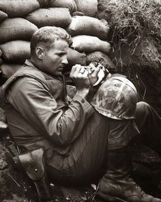 "The marine and the kitten, Korean War, 1952.  In the middle of the Korean War, this kitten found herself an orphan. Luckily, she found her way into the hands of Marine Sergeant Frank Praytor. He adopted the two-week-old kitten and gave her the name ""Miss Hap"" because, he explained, ""she was born at the wrong place at the wrong time."" There's a juxtaposition between the soldier and the human."