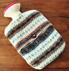 DIY Hot Water Bottle Cover made from a felted sweater. Cozy! ( by Hickory and Juniper)