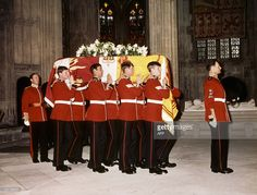 The catafalque of the Duke of Windsor, Britain's never-crowned King Edward VIII, is carried by Welsh Guardsmen from St George's Chapel, after a private funeral service in Windsor, Berkshire, 05 June 1972. The Duke, who died at his exiled home in France, was buried privately in the castle grounds at Frogmore? (Photo credit should read /AFP/Getty Images)