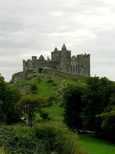 Rock of Cashel, Ireland. I love this place!  The Rock of Cashel sits on a hill over looking the village, it is so magnificent!