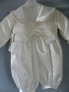 A boy's Christening outfit. http://www.weddinggownsinbangalore.com/admin/gallery/329Christening-Outfits-for-Boys.jpg