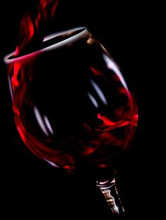 Red Wine Glass #dailyshoot #photoshop One of my first attempts at PS and a set up using a fast shutter speed and low light was able to capture the movement of the wine. Reflections added after processing. Not sure that this is my type of photography just yet but worth a try at least.