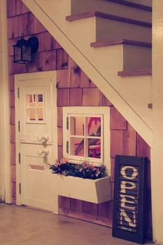 "A DIY Playhouse Under The Stairs. Love the ""OPEN"" sign made from a shutter. Very cute!"