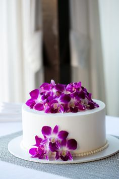 Purple orchid wedding cake with pearl border