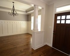 Add wainscoting a bit higher than half way up from the floor, add ...