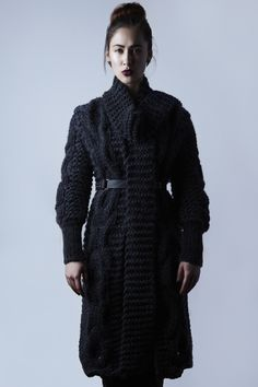 Heavily cabled hand knitted coat by Amy Hall -    just love it!