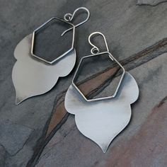 Honeycomb Lotus Earrings Sterling Silver Handcrafted Earrings I use a jewelers saw to hand cut each lotus petal out of flat solid sterling silver. The petals are soldered to hand crafted hexagons. The earrings are polished, oxidized, brushed, and polished some more for a rich, rustic patina. Total length from the top of the ear wire to the bottom of the earring is approximately 2 3/4 and they are 1 1/2 wide. Hand made entirely of solid sterling silver. These earrings are also available in...
