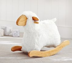 A sweet update on a classic children's toy, this rocking sheep is plush perfection.