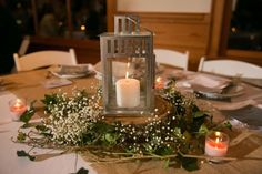 Lantern centerpiece - use these kind of lanterns outside, to go along with the galvanized metal pails