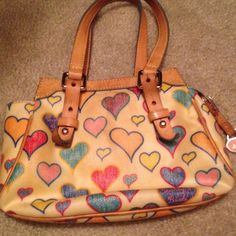 White Dooney and Bourke bag w/ hearts White Dooney bag has stains as you can see in pics. It is covered in hearts and has been used through the years Dooney & Bourke Bags