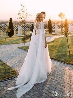 A Line Beaded Chiffon Boho Wedding Dresses with Cape Sleeves is part of Cape wedding dress This bohemian wedding dress features beaded bodice and flowy cape sleeves Finished with sweep tra - Chiffon Wedding Gowns, Lace Beach Wedding Dress, Western Wedding Dresses, Bohemian Wedding Dresses, Long Wedding Dresses, Bridal Gowns, Wedding Dress Cape, Lace Wedding, Gown Wedding