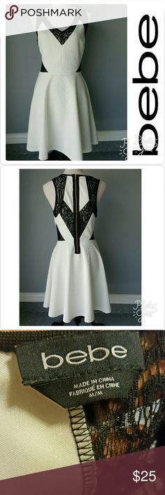 """🌸Bebe dress in great condition 🌸 🌸White Bebe, medium dress with black see thru lace design on the back and both sides of the dress around waistline and cleavage.   🌸For size chart and dress material see additional pictures or ask me anytime.  Dress length from shoulder down is approx. 36"""" bebe Dresses"""