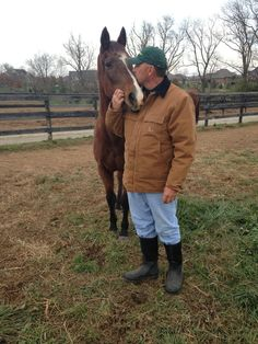 Ava Lotta Hope and volunteer John Bradley share a special moment on a cloudy, cold day at the farm.