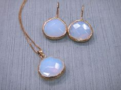 Moonstone and vermeil pendant and earrings at Glassando! Available in our Iowa City store! - The necklace has sold but the earrings are still available!  #Moonstone #Vermeil #Earrings #Unique #Handmade #Jewelry #IowaCity