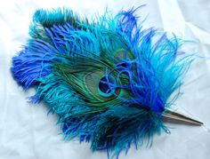 Morgan Ostrich Feather Hat Pin in peach with peacock eyes  Ostrich and peacock feathers flock together in this colorful Renaissance or Pirate hat pin design! Size: Approximately 12 long