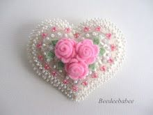 white and pink heart pin