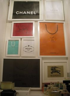 Shopping Bag Art...use simple IKEA white frames to frame favorite shopping bags ...places you have visited or just designs you love...great idea for a closet or ten decor too!