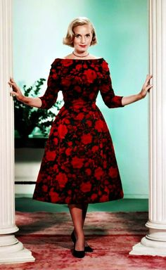 Eva Marie Saint as Eve Kendall in 'North by Northwest', 1959 - Director Alfred Hitchcock had primarily used Edith Head as the costume designer for his films. But for 'North by Northwest', Hitchcock procured costumes from Saville Row & this delightful, red floral print, silk dress worn by Eva Marie Saint in the Chicago sequence of the film. This dress was bought on a shopping spree at Bergdorf Goodman's in New York -