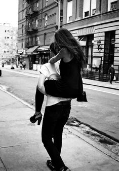Only a gentleman carries his woman so her heels don't get dirty
